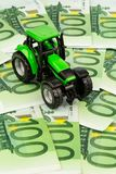 Tractor on euro banknotes royalty free stock photo