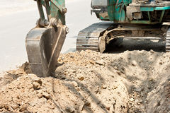 Tractor excavating. Soil trench for lay pipes Royalty Free Stock Photo