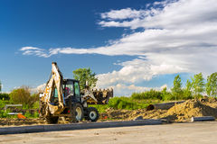 Tractor excavation work, construction speed road royalty free stock photography