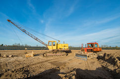 Tractor and excavator Stock Photography