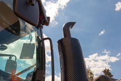 Tractor exhaust pipe. blue sky background. Royalty Free Stock Photography