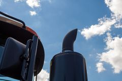 Tractor exhaust pipe. blue sky background. Royalty Free Stock Image