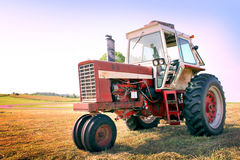 Tractor. A Farm Tractor in a Freshly Mowed Field Royalty Free Stock Image