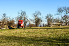 Tractor on farm meadow Royalty Free Stock Photo