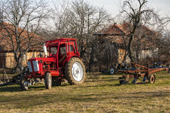 Tractor on farm meadow Stock Photos