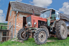Tractor on a farm in the village. Stock Image
