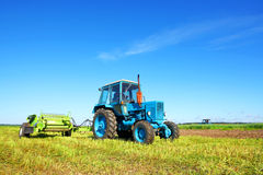 Tractor on a farmer field Stock Images