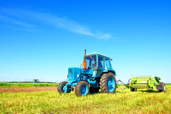 Tractor on a farmer field Royalty Free Stock Image