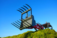 Tractor in a farmer field.The production of forage and hay. Stock Images