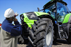Tractor with farmer, mechanic Stock Photography