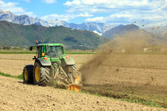 Tractor farming in field stock photography