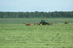 Tractor. Farming field machine grass Stock Photo