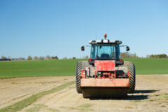 Tractor in farmland Stock Images