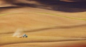 Tractor fertilize spring field. Before the seeding. Ukraine, Europe stock photos
