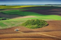 Tractor fertilize a spring field. Before the seeding. Ukraine, Europe stock photo