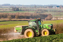 Tractor and fertilizer spreader in field Stock Photography