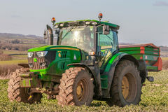 Tractor and fertilizer spreader in field Royalty Free Stock Photos