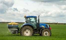 Tractor and fertilizer spreader in field Royalty Free Stock Images