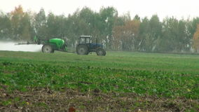 Tractor with fertilizer winter wheat stock video
