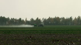 Tractor with fertilizer winter wheat stock footage