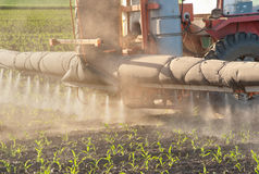 Tractor fertilizes crops Stock Photos