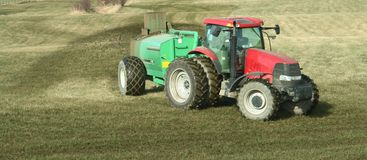 Tractor Fertilizing Farm Stock Image