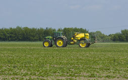 Tractor fertilizing field