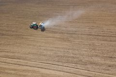 Tractor fertilizing field, Aerial View. Tractor spreading artificial fertilizers. royalty free stock photo