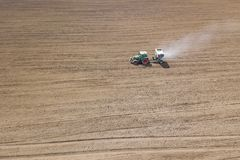 Tractor fertilizing field, Aerial View. Tractor spreading artifi. Cial fertilizers. Agriculture Aerial Stock Image