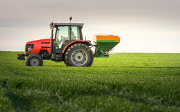 Tractor fertilizing in field Royalty Free Stock Photos