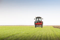 Tractor fertilizing in field Stock Images