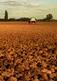 Tractor on a field Stock Photo