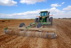 Tractor at field. Tractor working at the  field Royalty Free Stock Photography