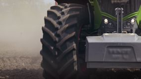 Tractor field. Agricultural tractor driving on arable field. Agricultural field stock footage