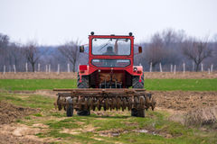 Tractor on a field Stock Photography