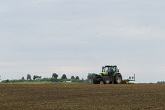 The tractor in the field on agricultural operations Stock Images