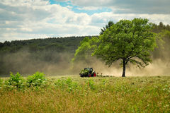 Tractor in a field Stock Photo