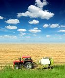 Tractor in the field in a blue sky day. Tractor in the field in a nice blue sky sunny day Stock Photo