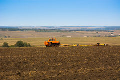 Tractor in the field of clean wheat crop.  Stock Photography