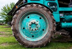 Tractor on the field cultivating and preparing arable land for the next season. Agronomy concept. Agriculture. Tractor on the field cultivating and preparing royalty free stock photos
