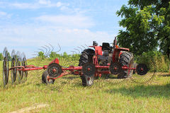 Tractor in Field with Hay Rake Royalty Free Stock Photo