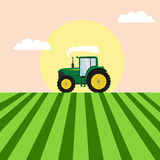 Tractor in a field image. Flat tractor in a field image Royalty Free Stock Photo