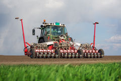 Tractor on field on job Royalty Free Stock Photos
