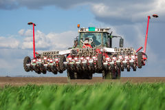 Tractor on field on job Stock Image