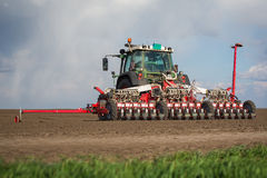 Tractor on field on job Stock Photography