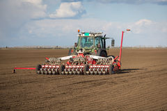 Tractor on field on job Royalty Free Stock Photo