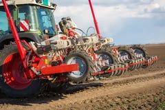 Tractor on field on job Stock Photo