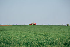 Tractor on field on job Royalty Free Stock Photography