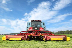 Tractor on the field. Tractor mowing of fodder grasses on the field Royalty Free Stock Photo