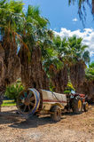 Tractor on the field. Of the national park Sama with trees in the background and blue nice sky Stock Photo